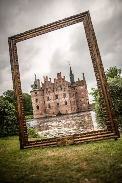Egeskov Castle framed within a large picture frame